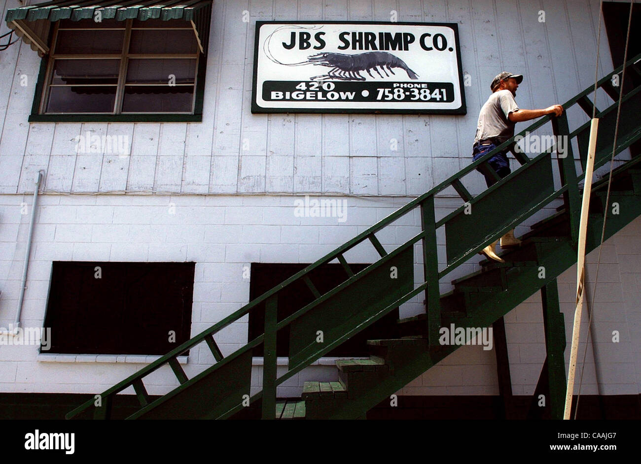 Jeff Noel climbs the stairs to settle the bill at JBS Shrimp Company in Aransas Pass. He bought ice and fuel and - Stock Image