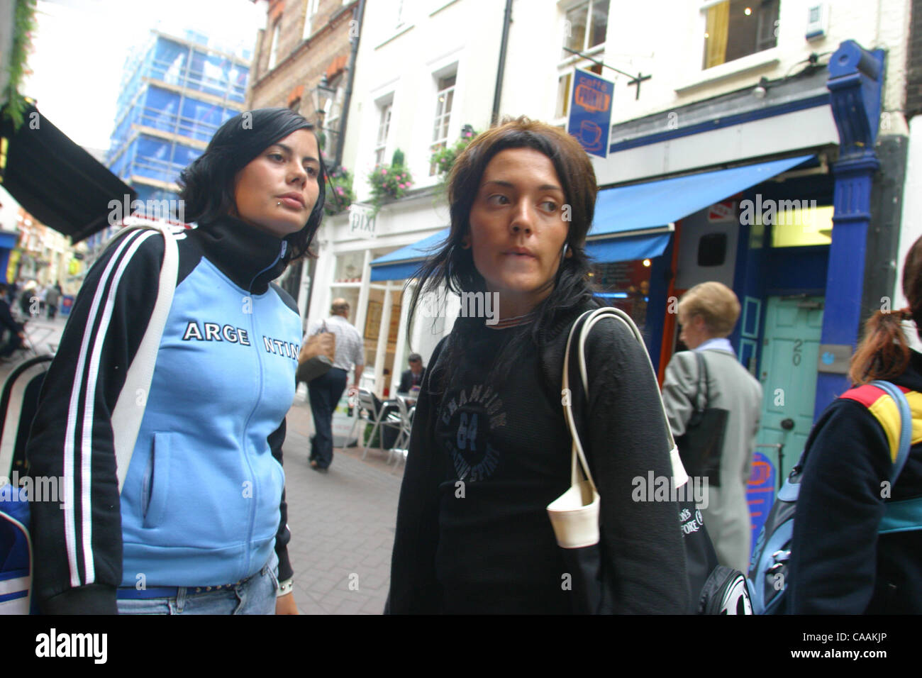 Sep 25 2003 London UK Trendy Young Londoners 2 Girls Hanging Out In The Streets Shopping Smoking And Having A Good Time Soho Is To What
