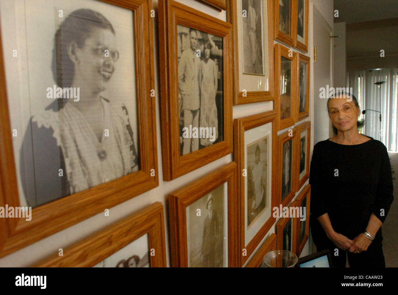 Betty Reid Soskin stands by her wall of family photos that range from the late 1800s to the early 1900s on Friday - Stock Image