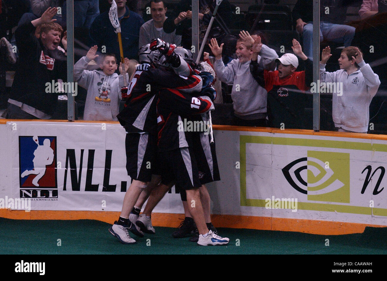 (RIGHT) San Jose Stealth's Phil Sanderson, #18, celebrates with teammates (L-R) Chris White, #6, and Andrew - Stock Image
