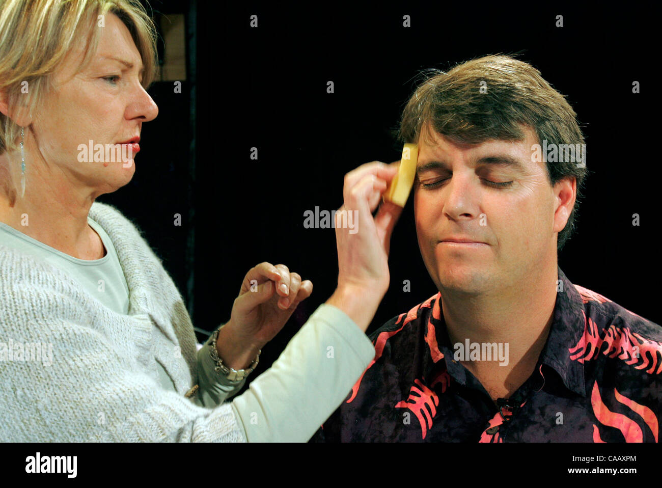 Hot Topics executive producer INGRID HOFFMEISTER does final touches on the face of the show's host T. PAT STUBBS - Stock Image