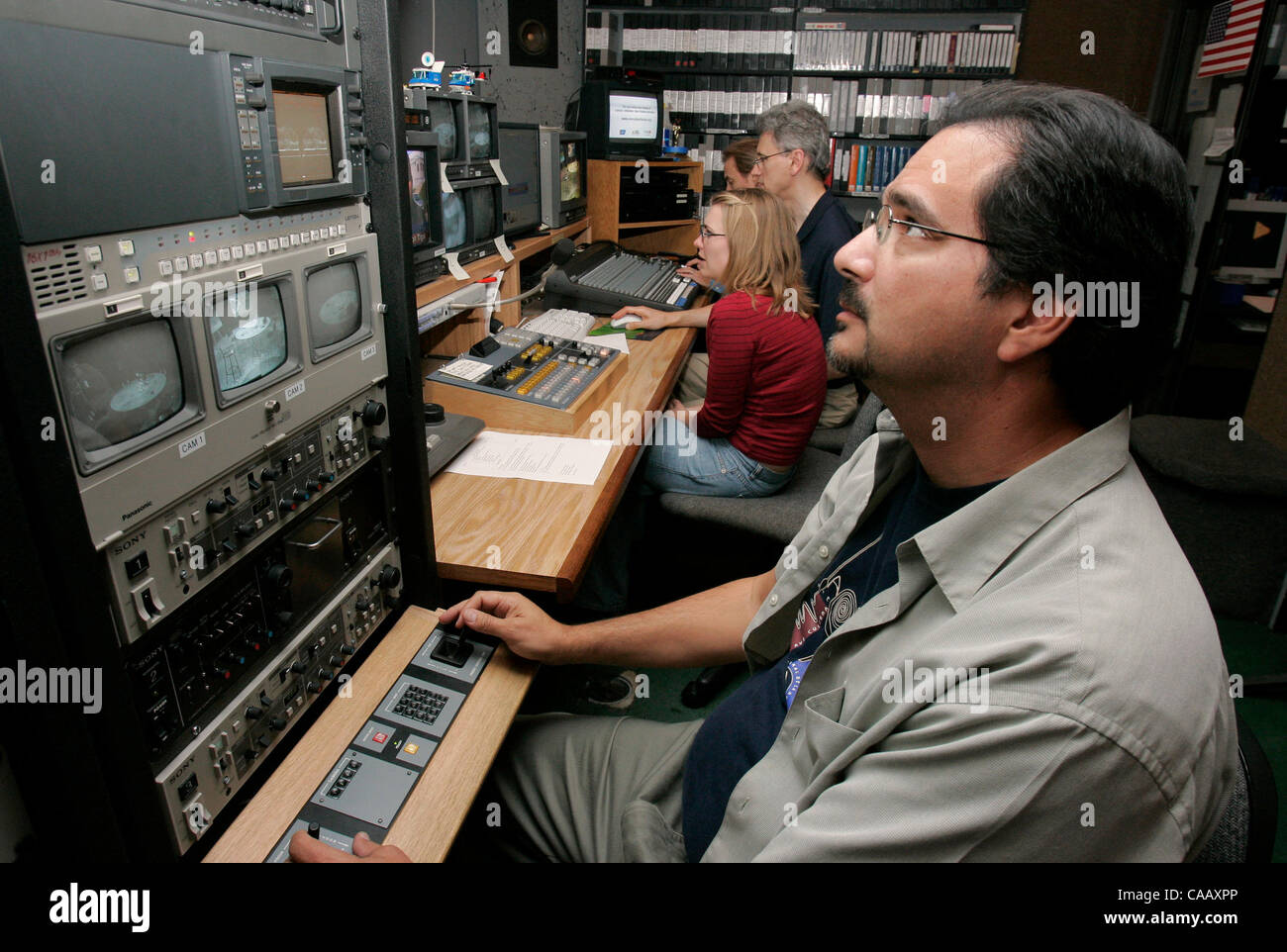 Prior to the filming of Hot Topics the show's director EDWARD KRAMER works in the control room. In the distance - Stock Image