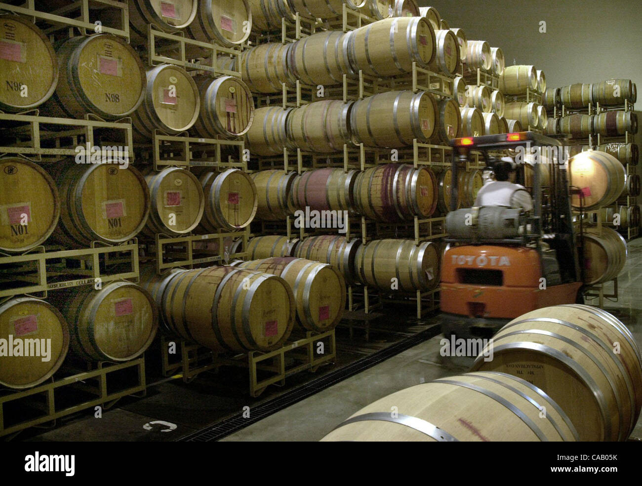 An employee moves barrels at Rosenblum Cellars in Alameda Calif. on Friday March 5 2004. The Alameda winery is talking with a Brentwood developer about ... & An employee moves barrels at Rosenblum Cellars in Alameda Calif. on ...