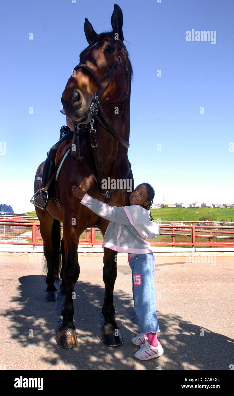 STANDALONE--Paige Allen cq (right), a first grader, hugs U.S. Park Police horse 'Gentle Ben' at MNO Grant - Stock Image
