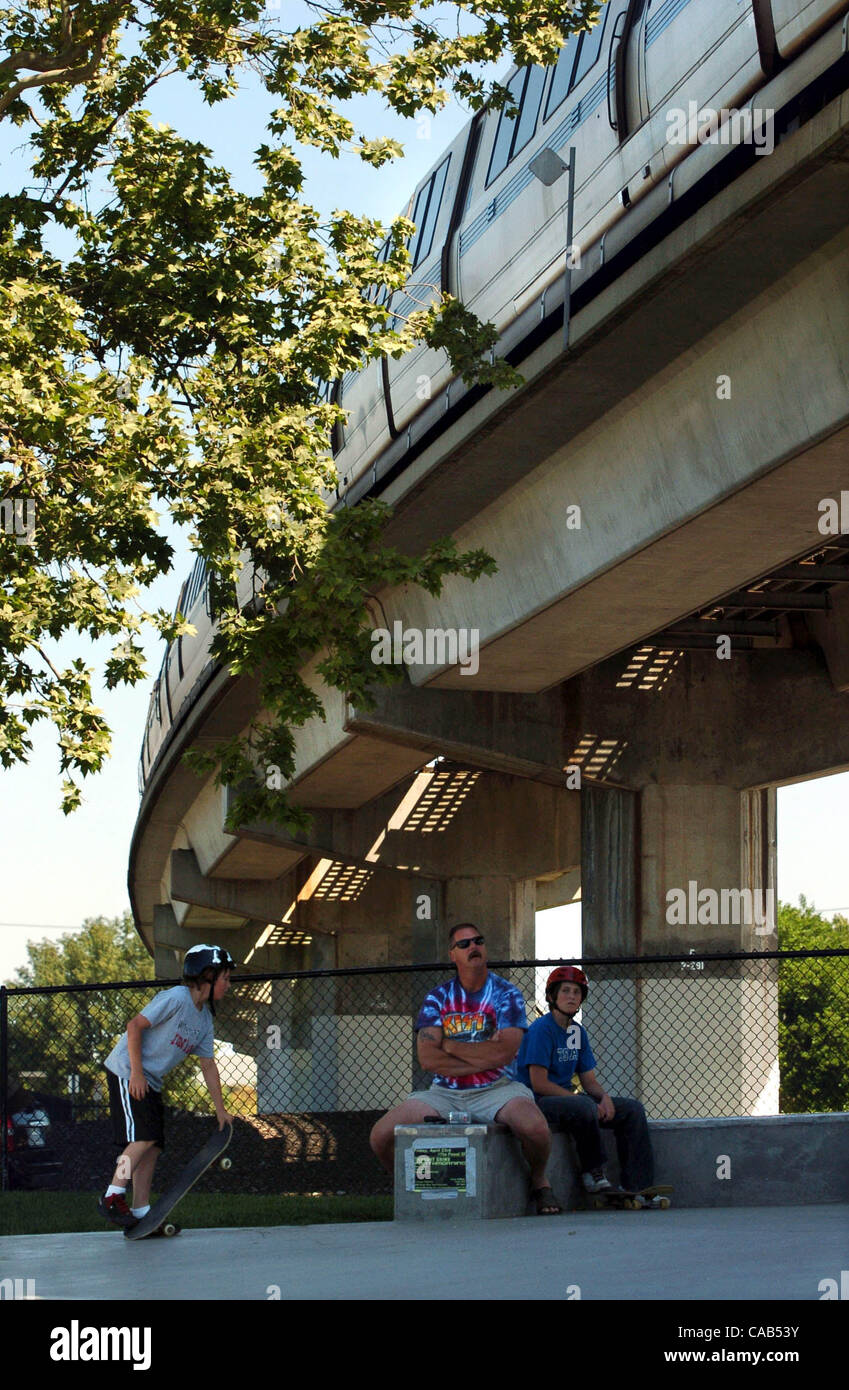 Bruce Leamer looks up at a passing BART train as he joins his son's Chase, left, and Tyler riding Saturday morning - Stock Image