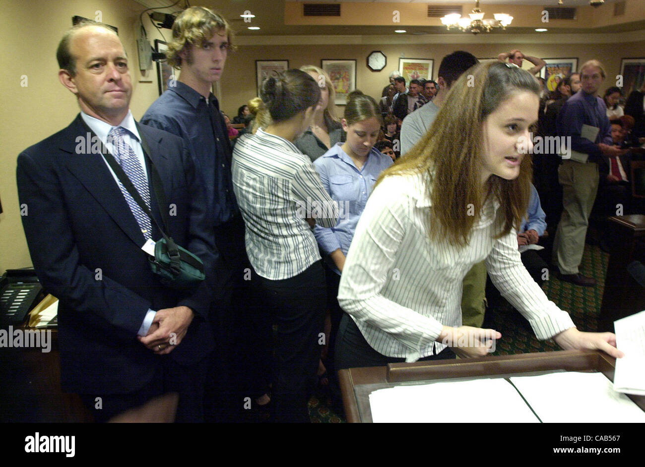 Standalone--As her teacher, Larry Freeman, left, stands by, Acalanes High School senior Danielle DiTirro gives a Stock Photo
