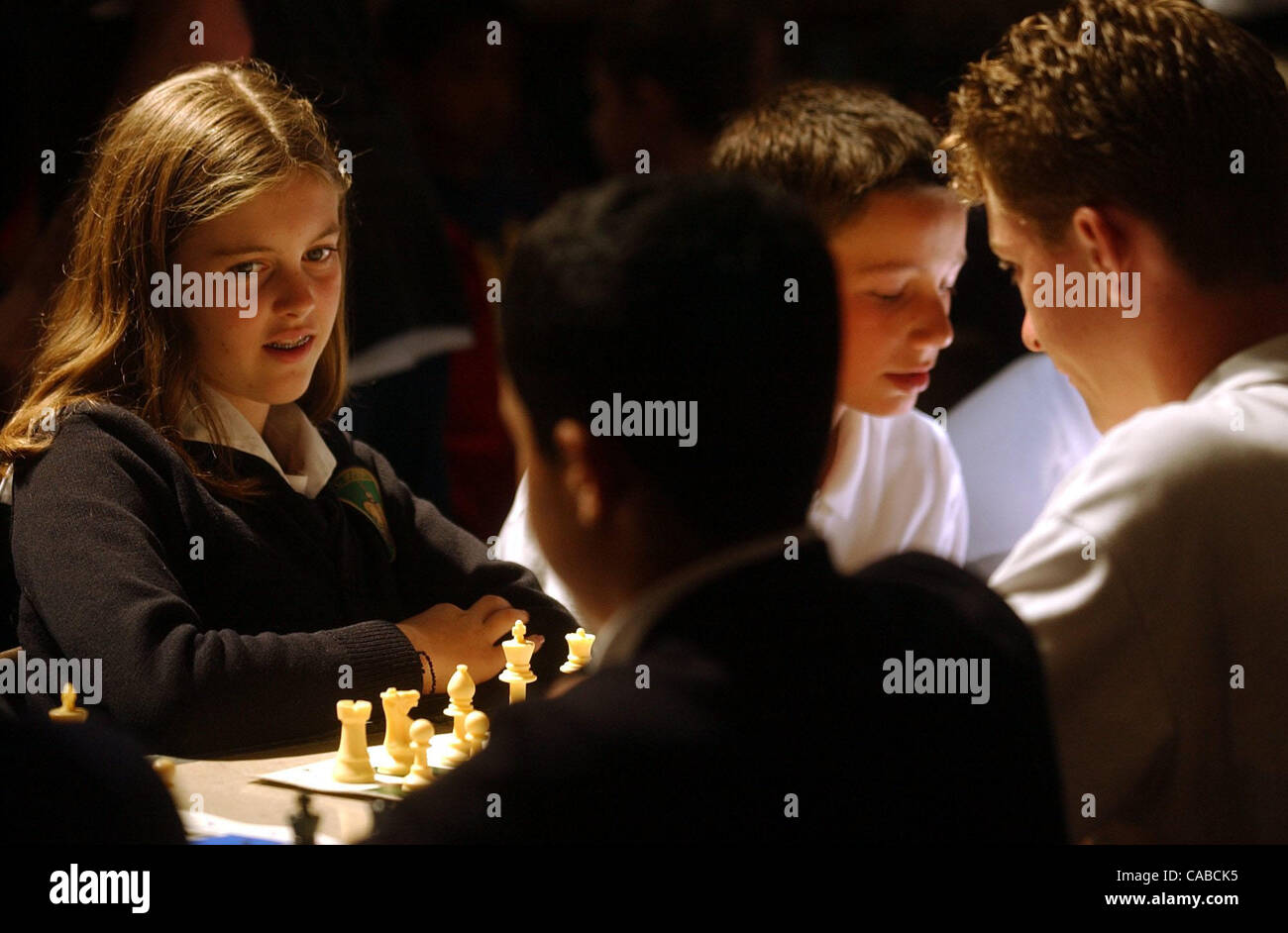St. Joseph's seventh grader Lily Smith watches her neighbor's move while waiting for her opponent at the - Stock Image