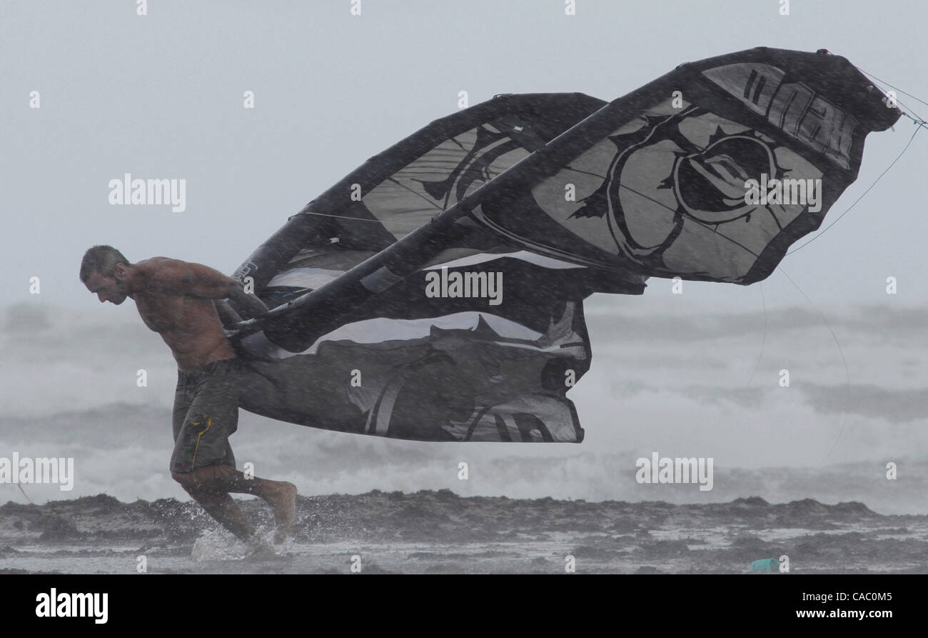 June 29, 2010 - Port Aransas, Texas, USA - 06/29/2010. A kiteboarder struggles thru strong winds and a rain squall - Stock Image