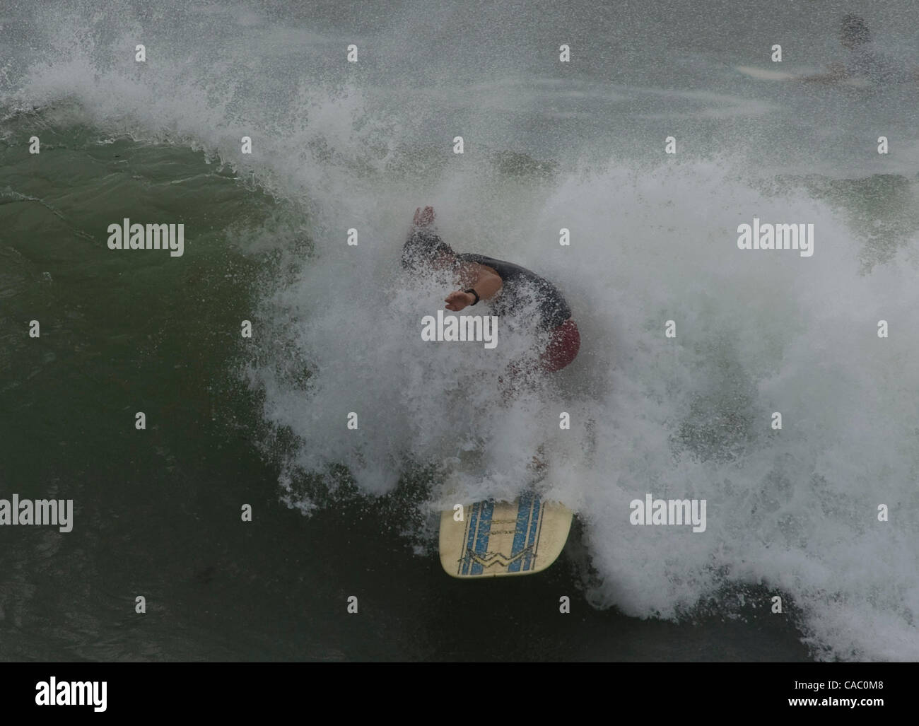 June 29, 2010 - Port Aransas, Texas, USA - 06/29/2010. A surfer takes advantage of the swell created by hurricane - Stock Image