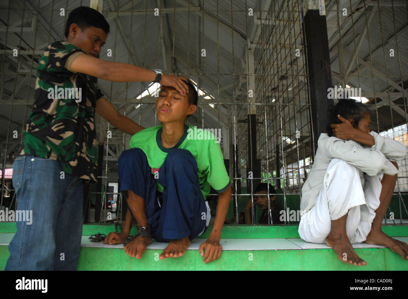 Head Nurse Suharyono Gives A Mental Patient Treatment At The Galuh Foundation For Patients In East Bekasi Near Jakarta West Java