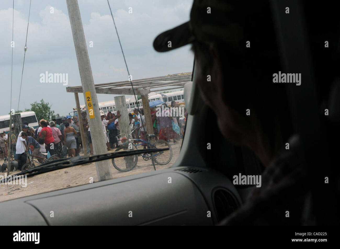 Aug 10, 2010 - Matamoros, Mexico - CHUCK HURMAN looks out from the wind sheild of a Frank Ferree Border Relief truck - Stock Image