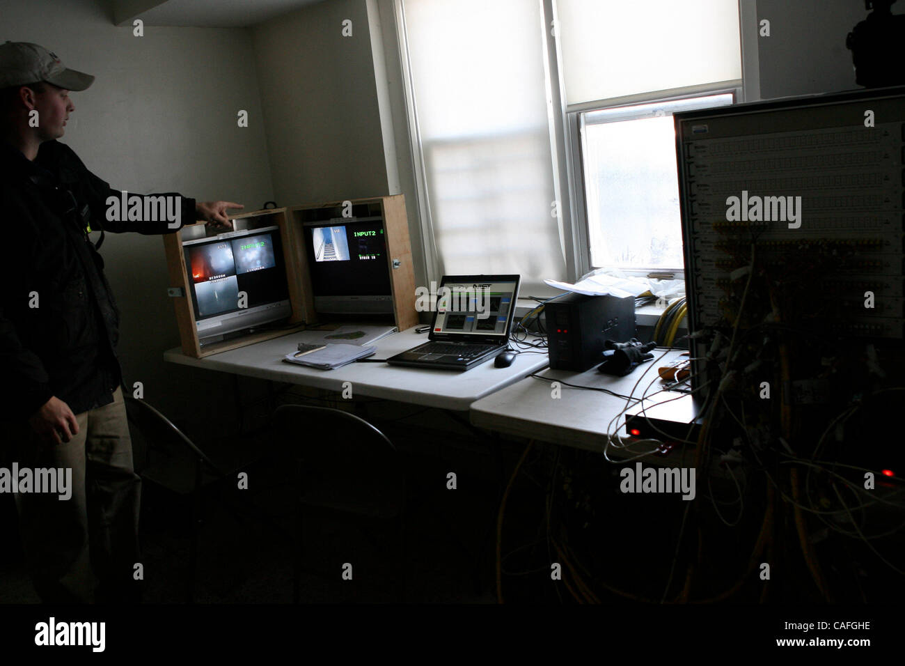 Stephen Kerber of NIST (National Institute of Standards and Technology) checking the computers during the fire training - Stock Image