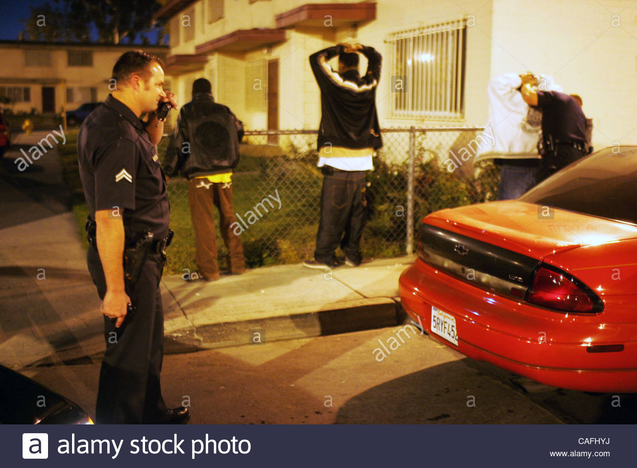 Los Angeles Police officer Tim Pearce keeps an eye on gang members in the  Jordan Downs Housing Projects in South Los Angeles Tuesday December 5, 2006.