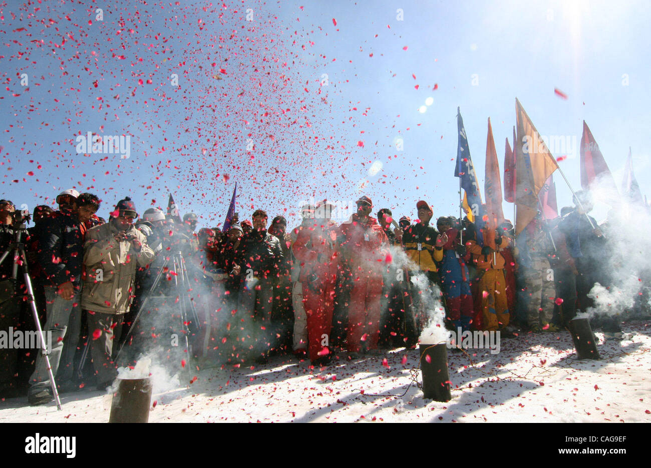 Flower petals are thrown in the air during the opening ceremony of the National Winter Games in Gulmarg, 55km (34 - Stock Image