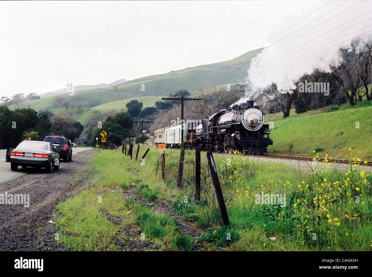EX-SOUTHERN PACIFIC 2472, last used in revenue service pulling commuter  trains on the Peninsula, backs down Niles Canyon west of Sunol on Monday  afternoon ...