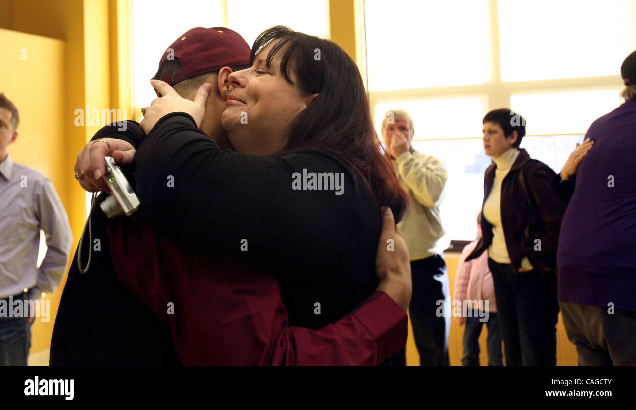 Surrogate mother Joan Klossner gave Shady Salamon a tearful hug at the end of signing day ceremonies at Cretin-Derham - Stock Image