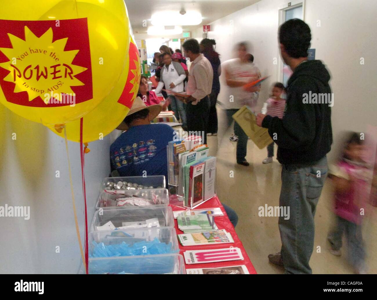 Visitors peruse the literature at various tables during the National Black HIV/AIDS Awareness Day Health Fair on - Stock Image
