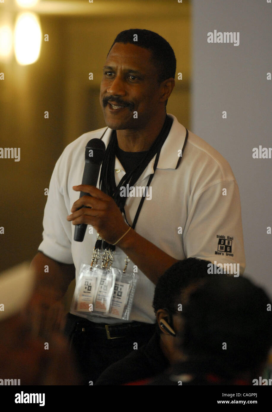 Chairman of the Diablo Black Mens Group, John Lane, encourages fundraising for the club at the annual Super Bowl - Stock Image