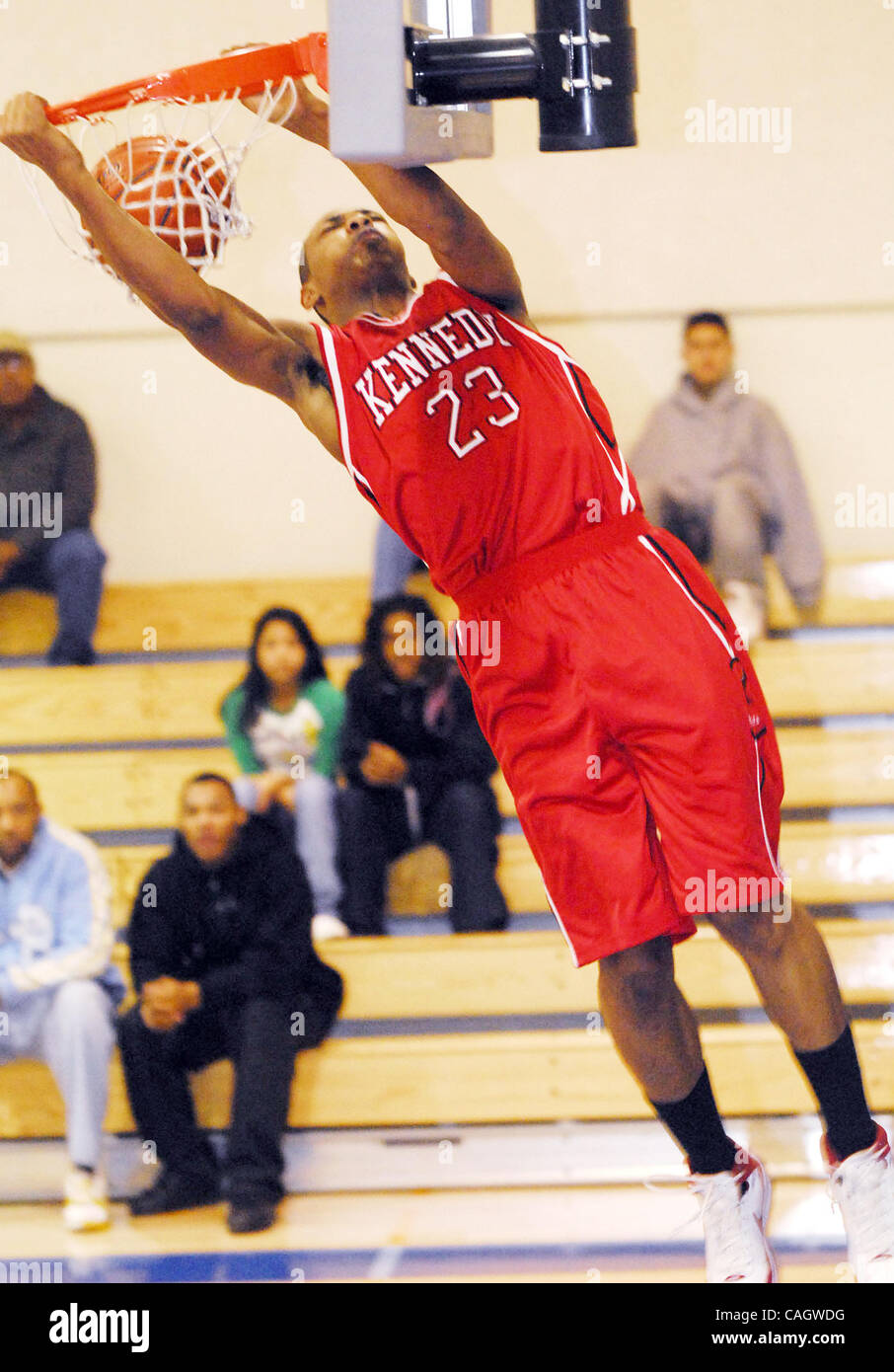 Kennedy's Jonathan Williams finishes a fast break dunk during their prep basketball game vs. St Joseph's - Stock Image