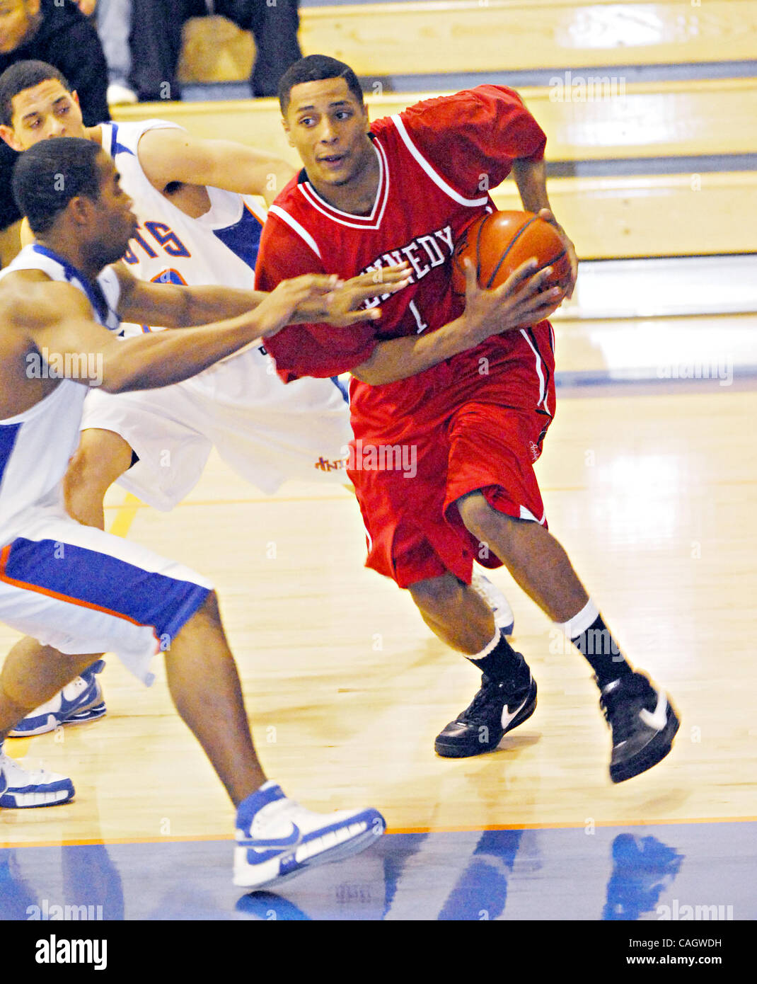 Kennedy's Marvin Boadu (right) tries to drive past St Joseph's defenders  during their prep basketball game - Stock Image
