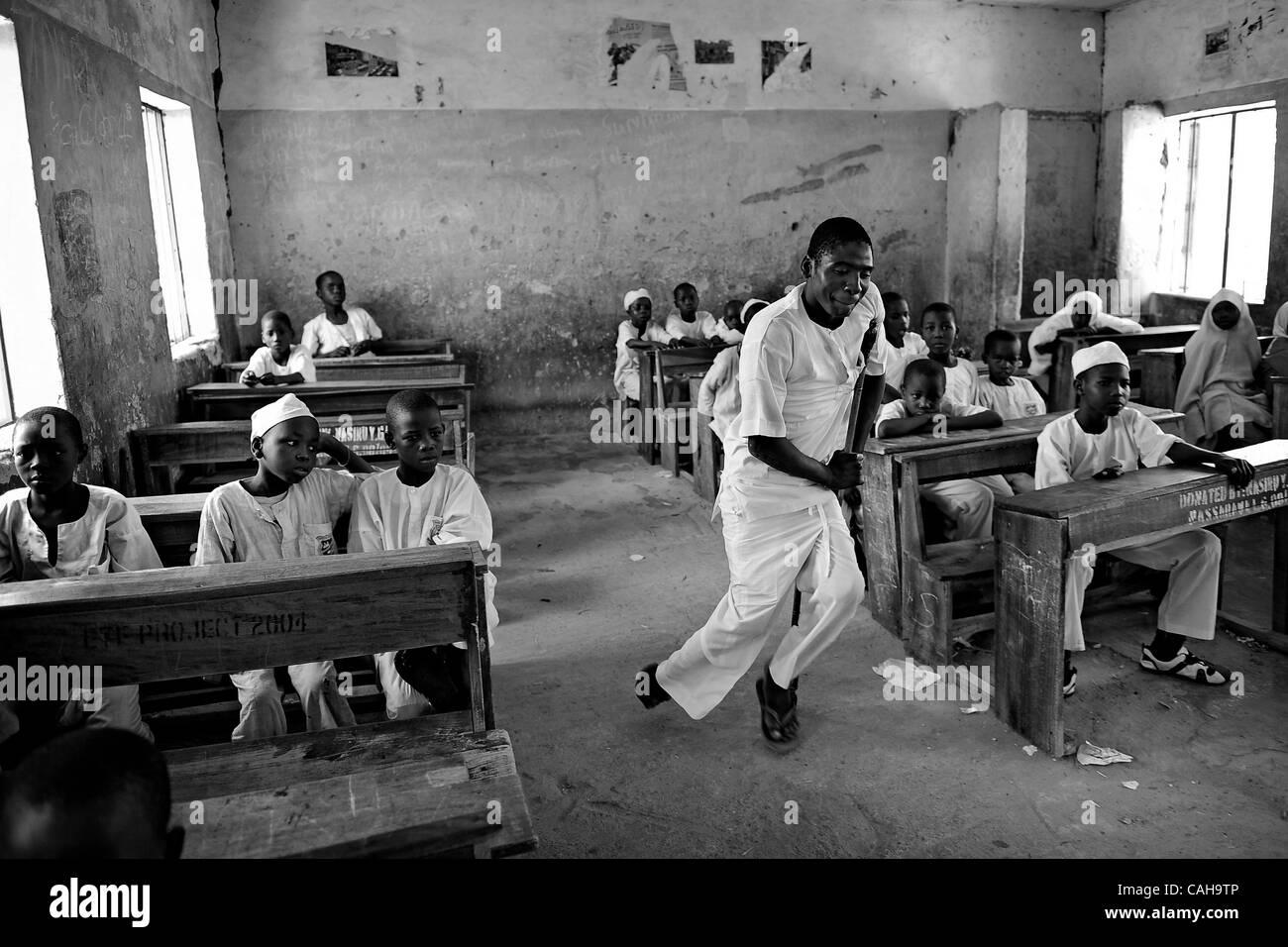 Jan. 2, 2011 - Kano, KANO, NIGERIA - ABDULLAHI ALASAN, 18, struggles to walk to the front of the classroom.  Alasan - Stock Image