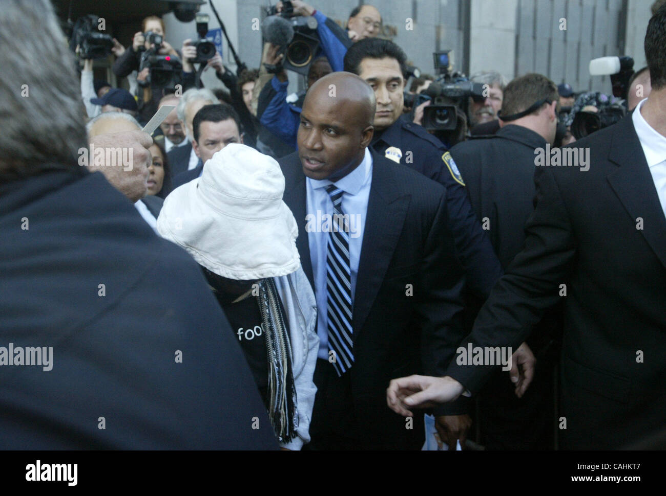 Barry Bonds leaves from his arraignment on federal perjury charges at the Phillip Burton Federal Courthouse in San - Stock Image