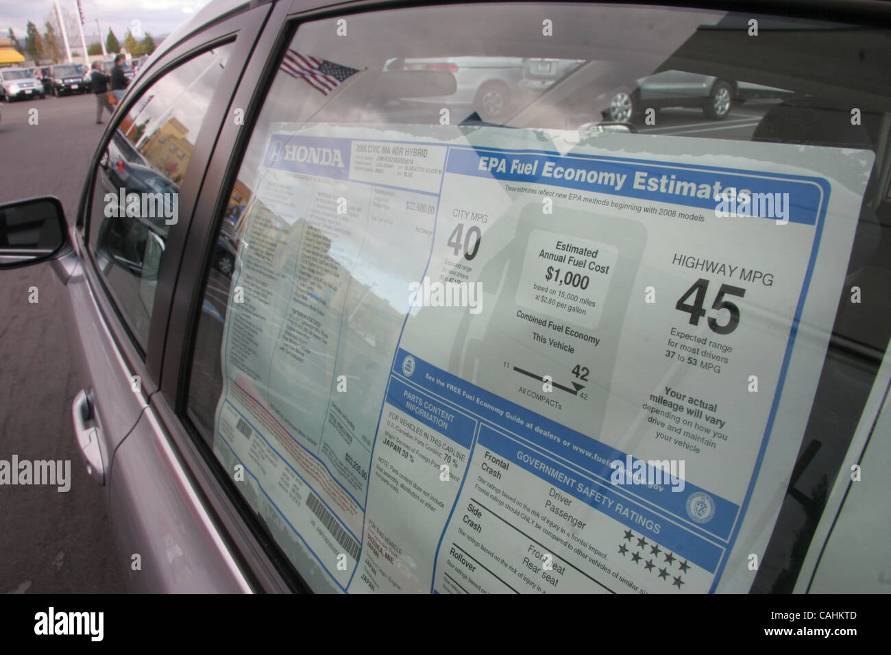 A 2008 Honda Civic hybrid sticker indicates a 45 MPG highway rating  on Friday, Dec. 7, 2007, in Pleasanton, Calif. - Stock Image