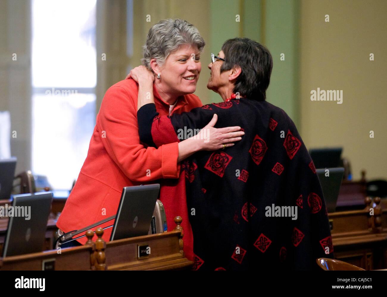 Assembly members Julia Brownley, D- Santa Monica, left, hugs fellow member Patty Berg, D-Eureka, as the Assembly - Stock Image
