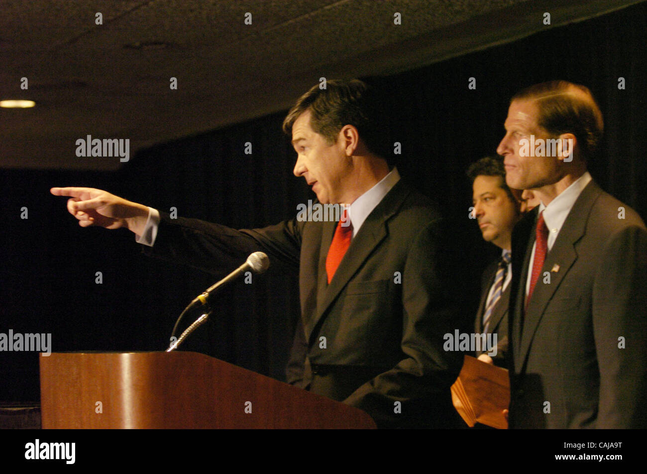 North Carolina Attorney General Roy Cooper points while speaking at the press conference. In a joint effort to increase - Stock Image