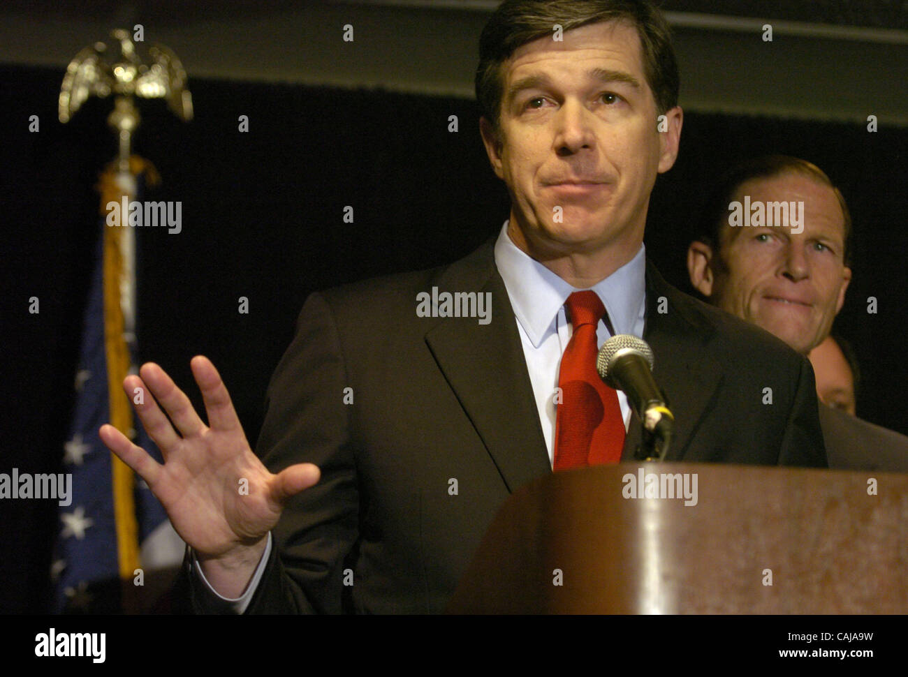 North Carolina Attorney General Roy Cooper gestures while speaking at the press conference. In a joint effort to - Stock Image