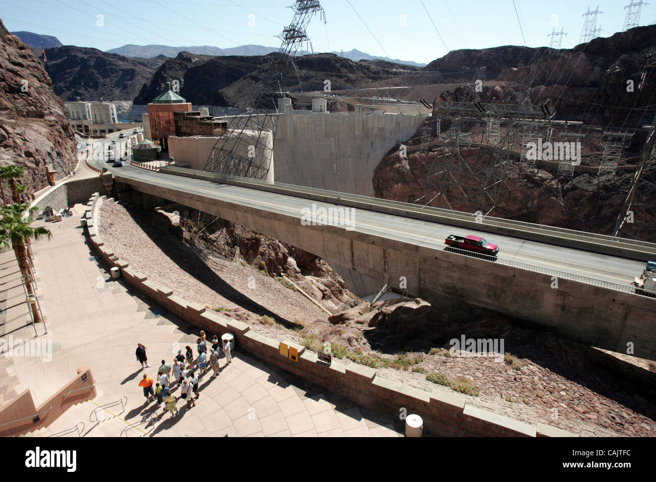 Hoover Dam, also known as Boulder Dam, is a concrete gravity