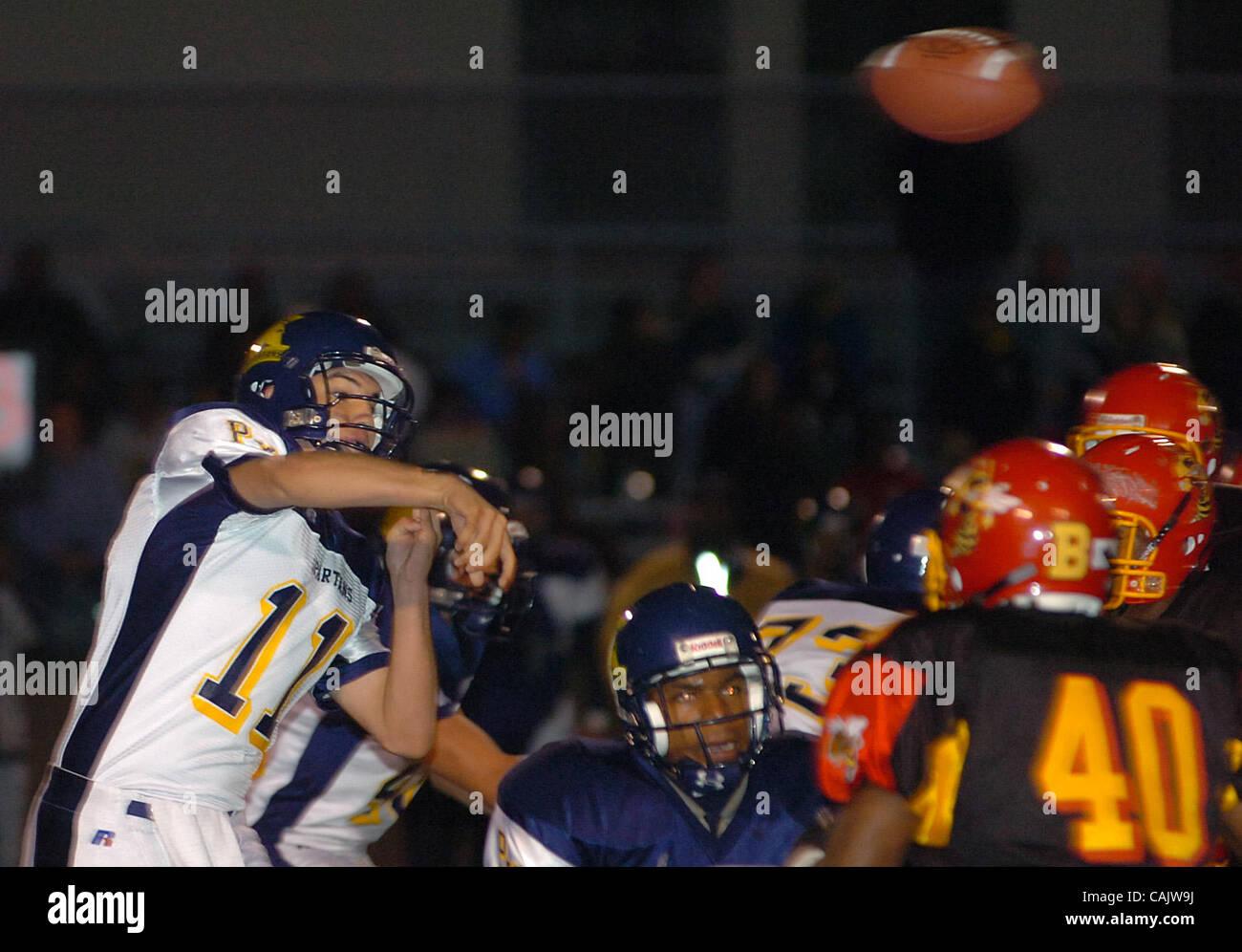 Pinole Valley High quarterback (#11) Derek Crenshaw throws over Berkeley High defenders during their game in Berkeley, - Stock Image