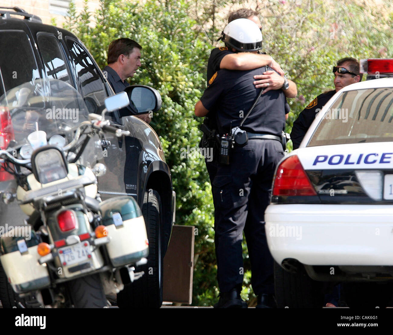 METRO- San Antonio Poice officers hug each other outside