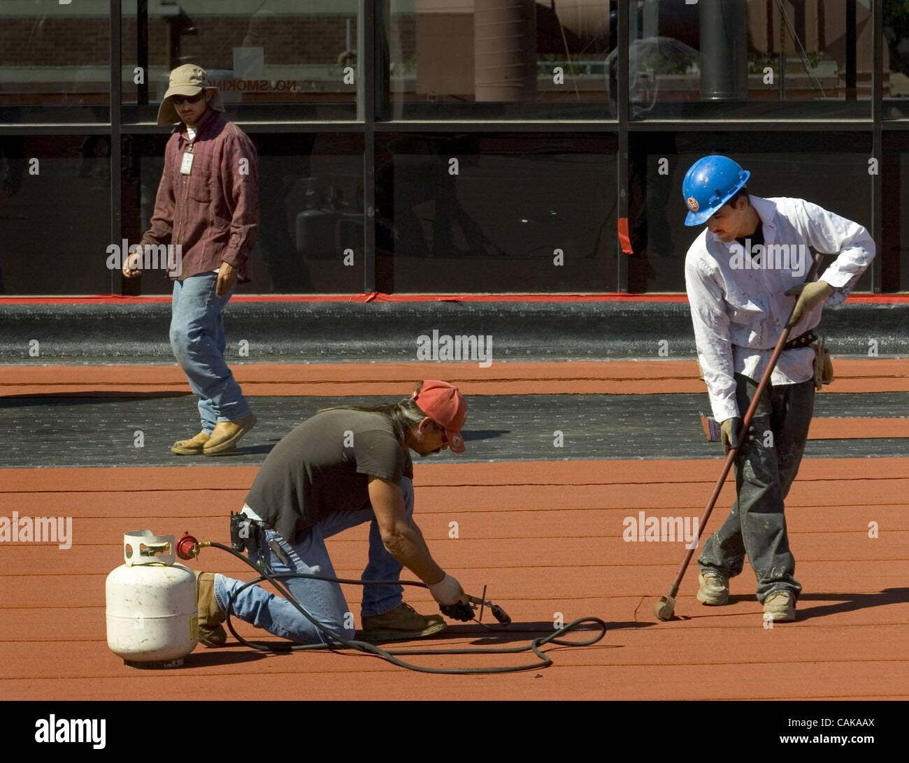 Foreman Tony Robles Of Hester Roofing Cq Center Works With Stock Photo Alamy