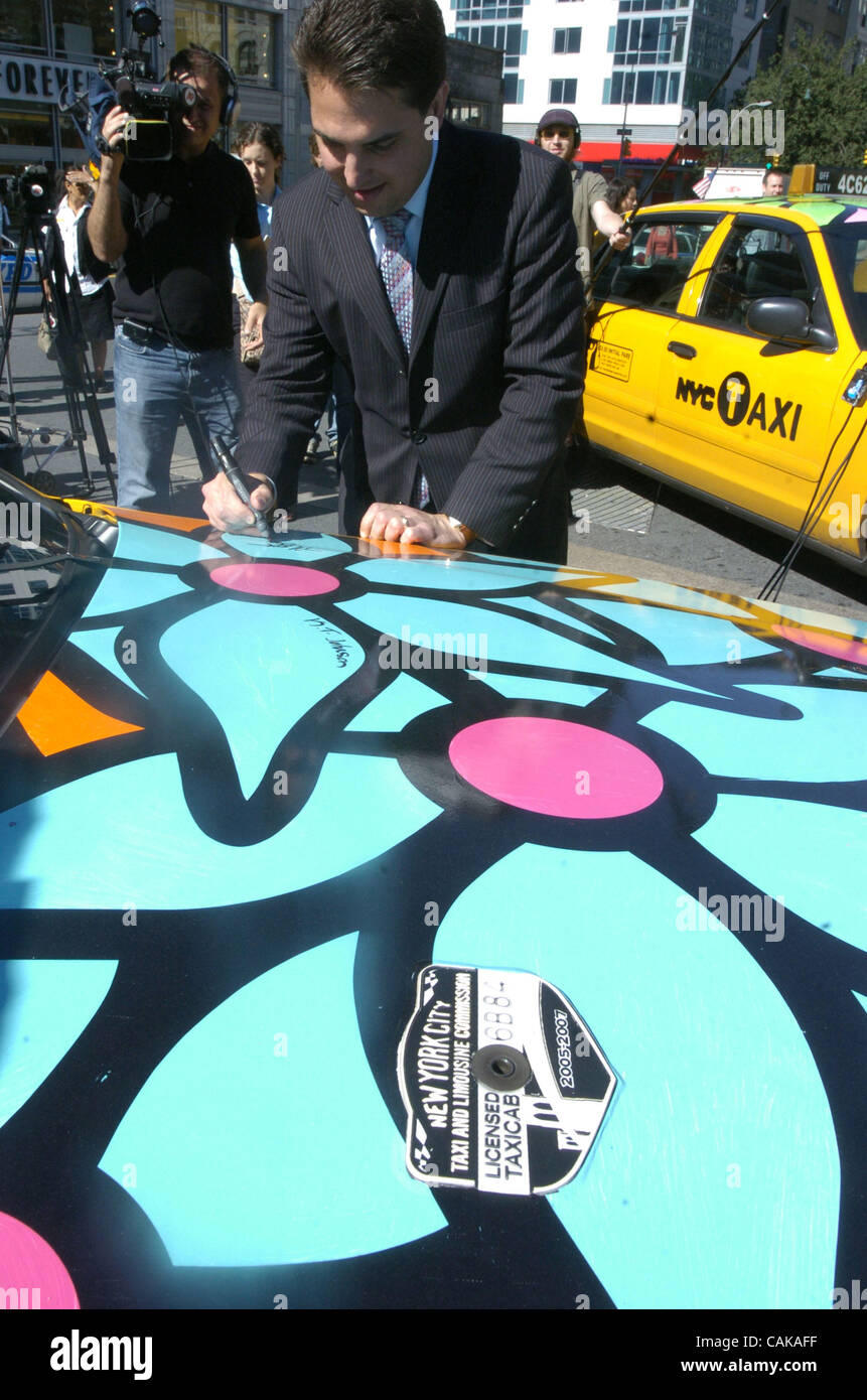 TLC Commissioner and Chair Matthew Daus signs the hood of a