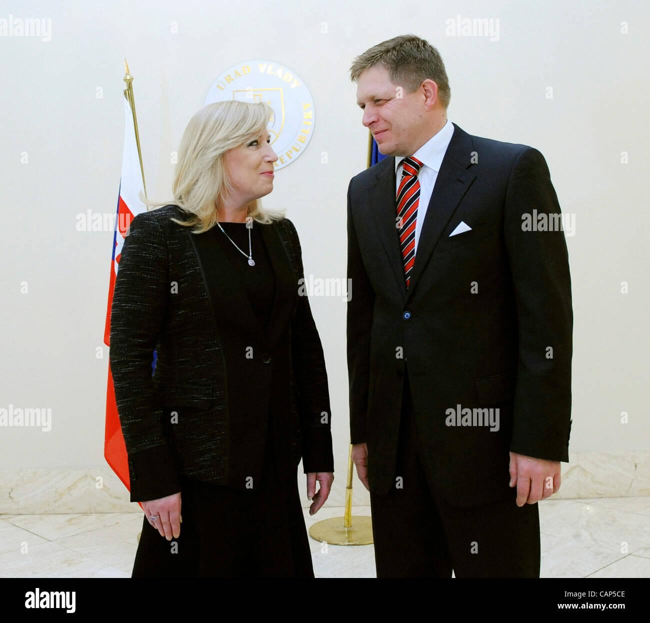 New Slovak Prime Minister Robert Fico, right, and his predecessor Iveta Radicova pose for photographs during a handover - Stock Image