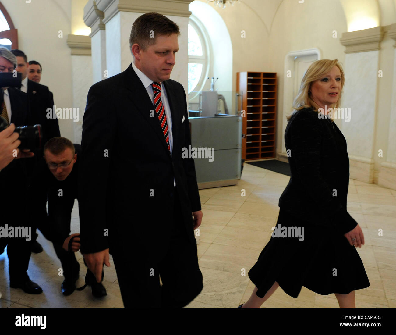 New Slovak Prime Minister Robert Fico, left, and his predecessor Iveta Radicova pose for photographs during a handover - Stock Image