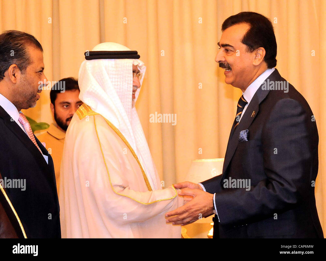 Prime Minister Syed Yousuf Raza Gilani Shakes Hand With Saudi Arabia Information And Culture Abdul Aziz Bin Mohayyuddin Khoja During Meeting At