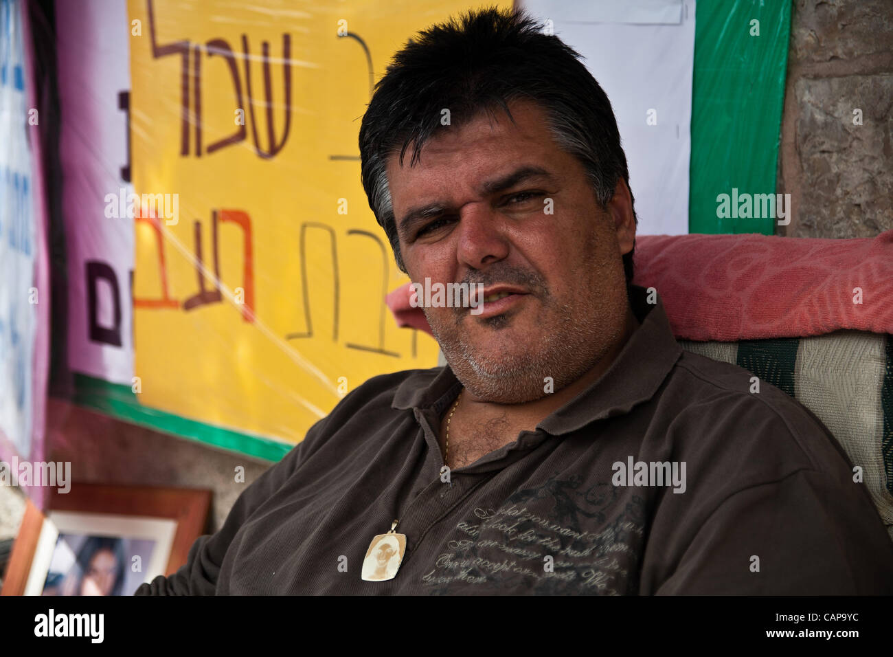 Kobi Sarusi, who lost his 14 year old daughter, Linoi Sarusi, to a terrorist attack in October 2002, wears a pendant - Stock Image
