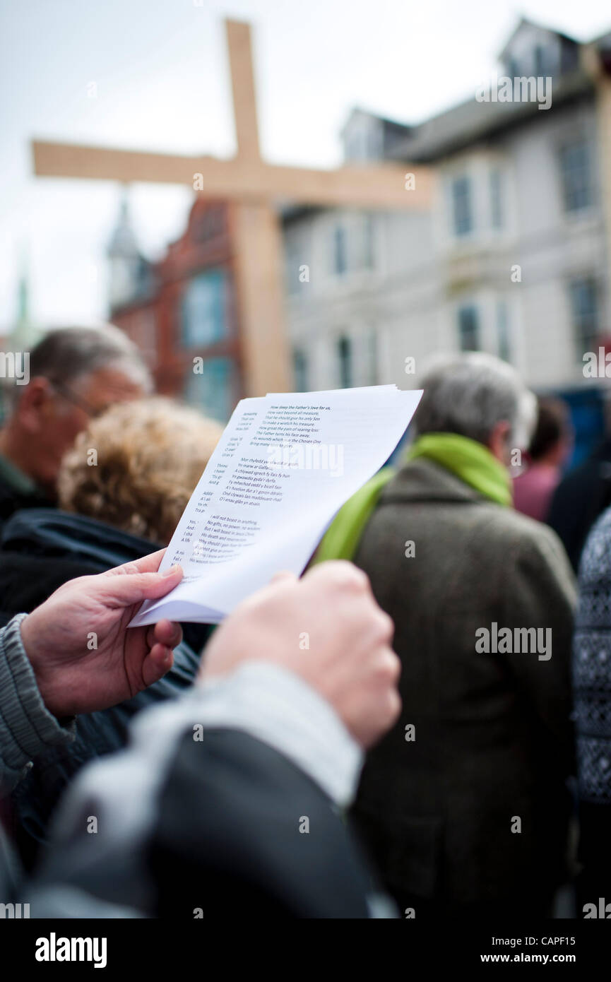 A group of Christians gather for a Good Friday open air prayer meeting and worship on the street in Aberystwyth, - Stock Image