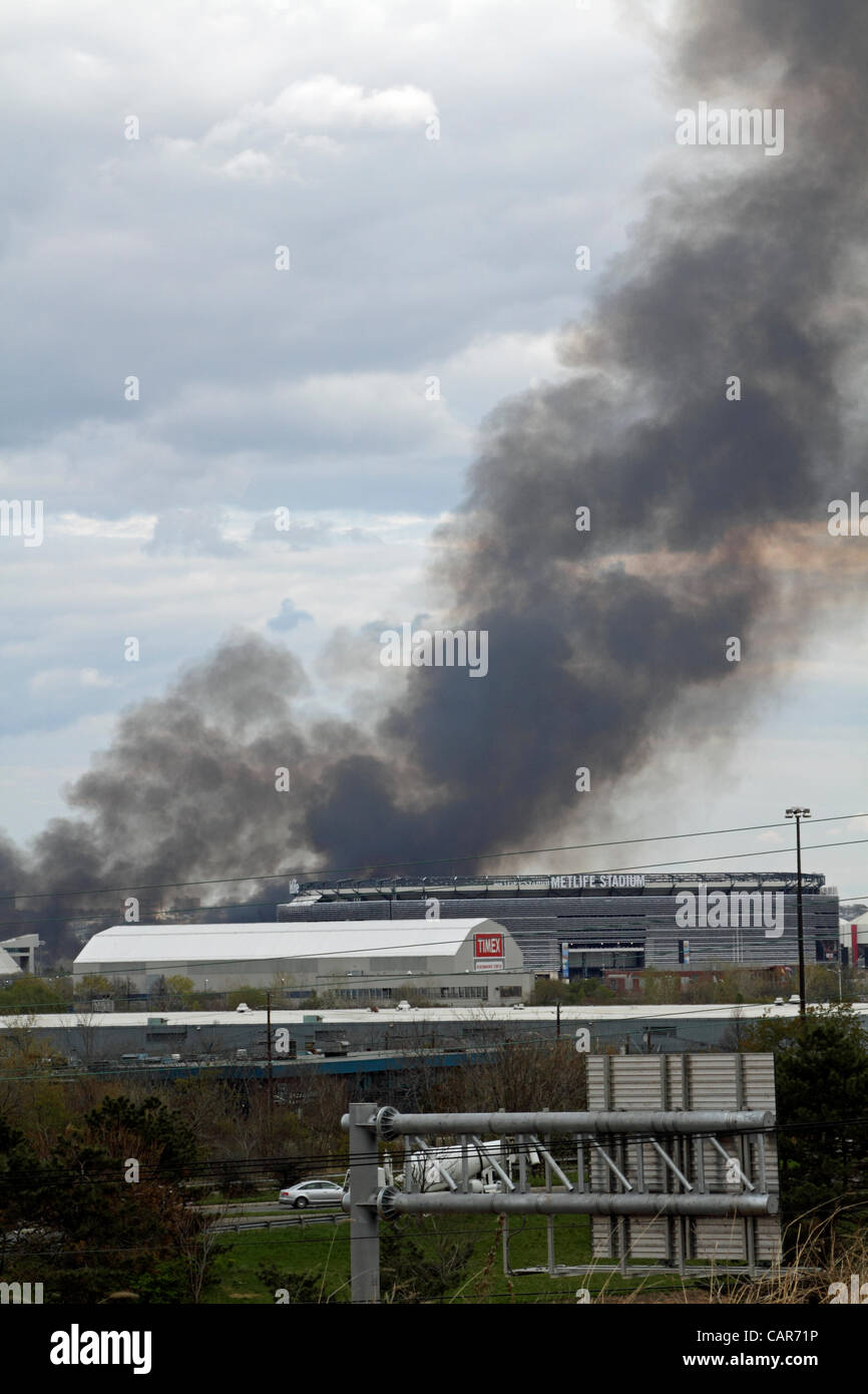 A large brush fire burning in the Meadowlands of Carlstadt, New Jersey on April 11, 2012 near the Met-Life Stadium - Stock Image
