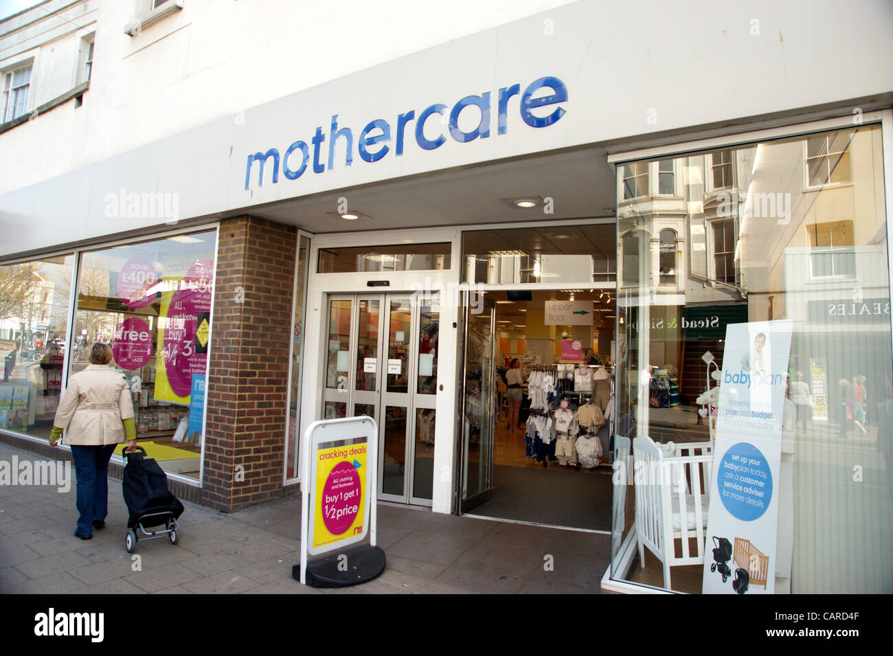 Mothercare retailer shop in the high street Worthing West Sussex (one of the many retailers now closed on the high - Stock Image