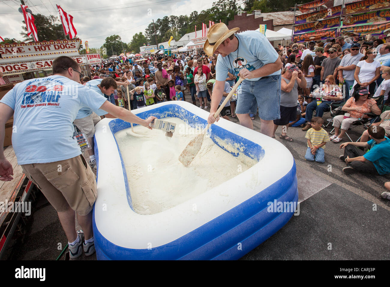 Workers prepare a pool of instant grits at the World Grits Festival April 14, 2012 in St. George, SC. The festival - Stock Image