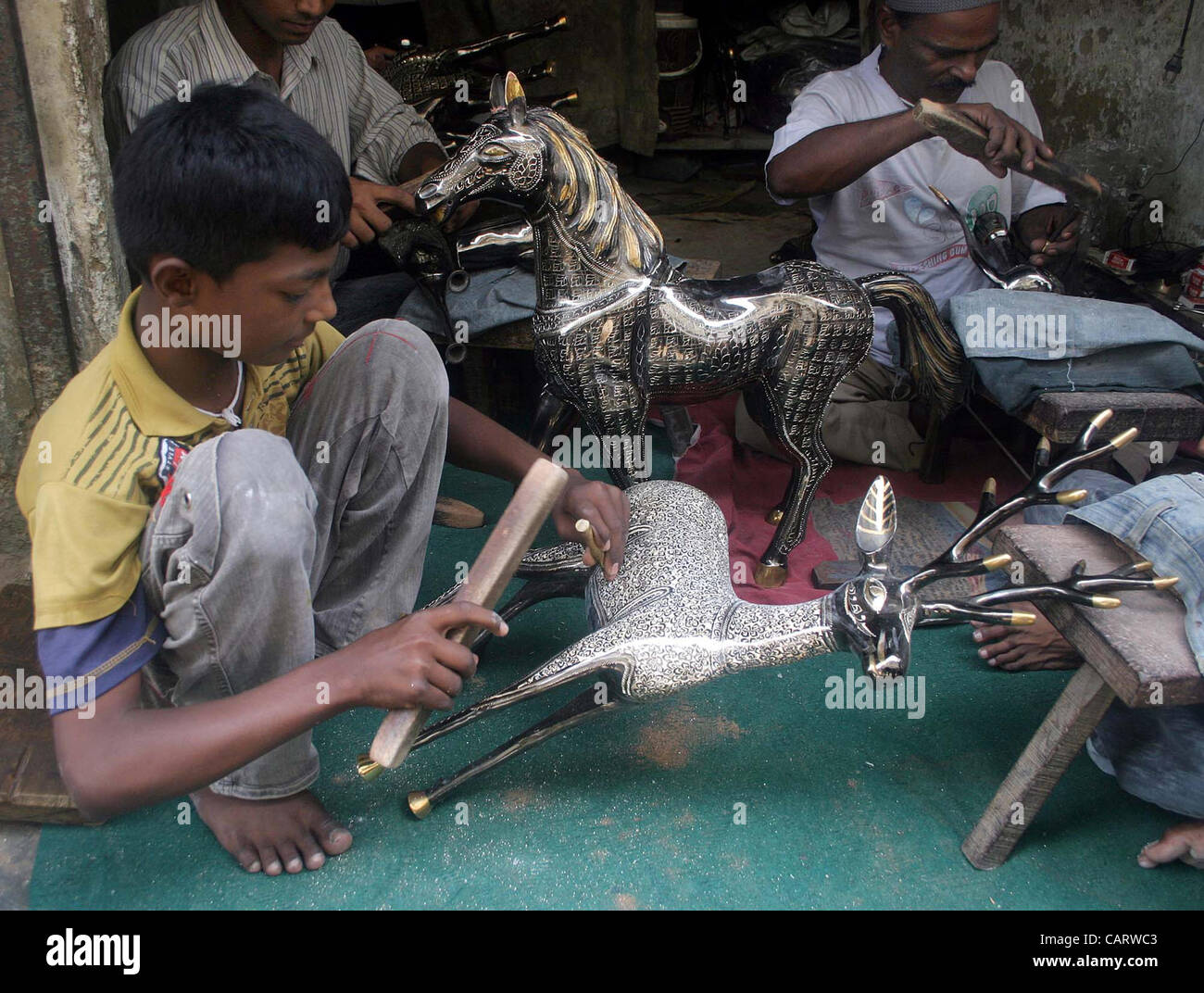 Artisans Give Final Touch To Brass Made Home Decoration Items At A Workshop  In Karachi On Monday, April 16, 2012.