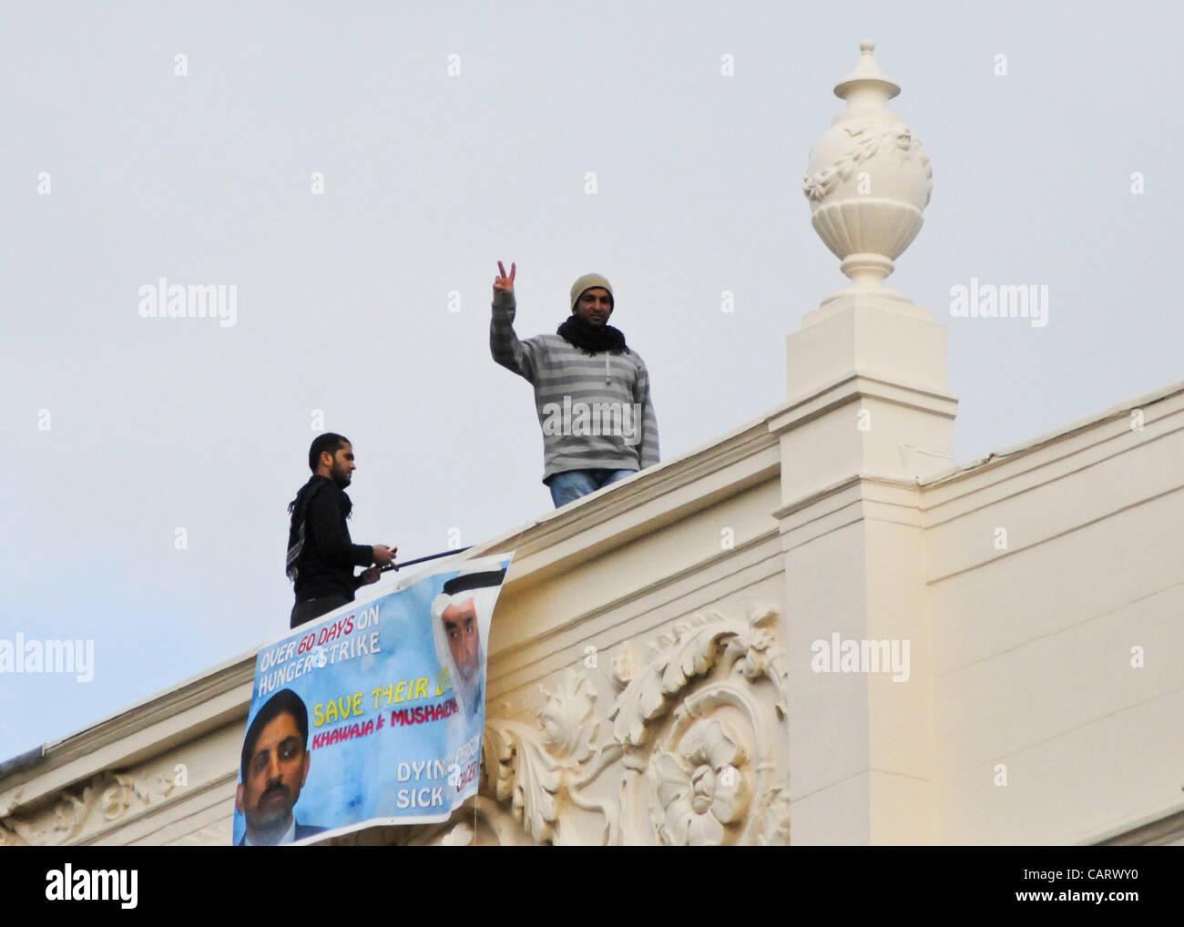 London UK 16 04 12 Bahraini Hunger Strikers Ali Mushaima Left And Mosa Abd Protesting On The Roof Of Embassy Kingdom Bahrain In