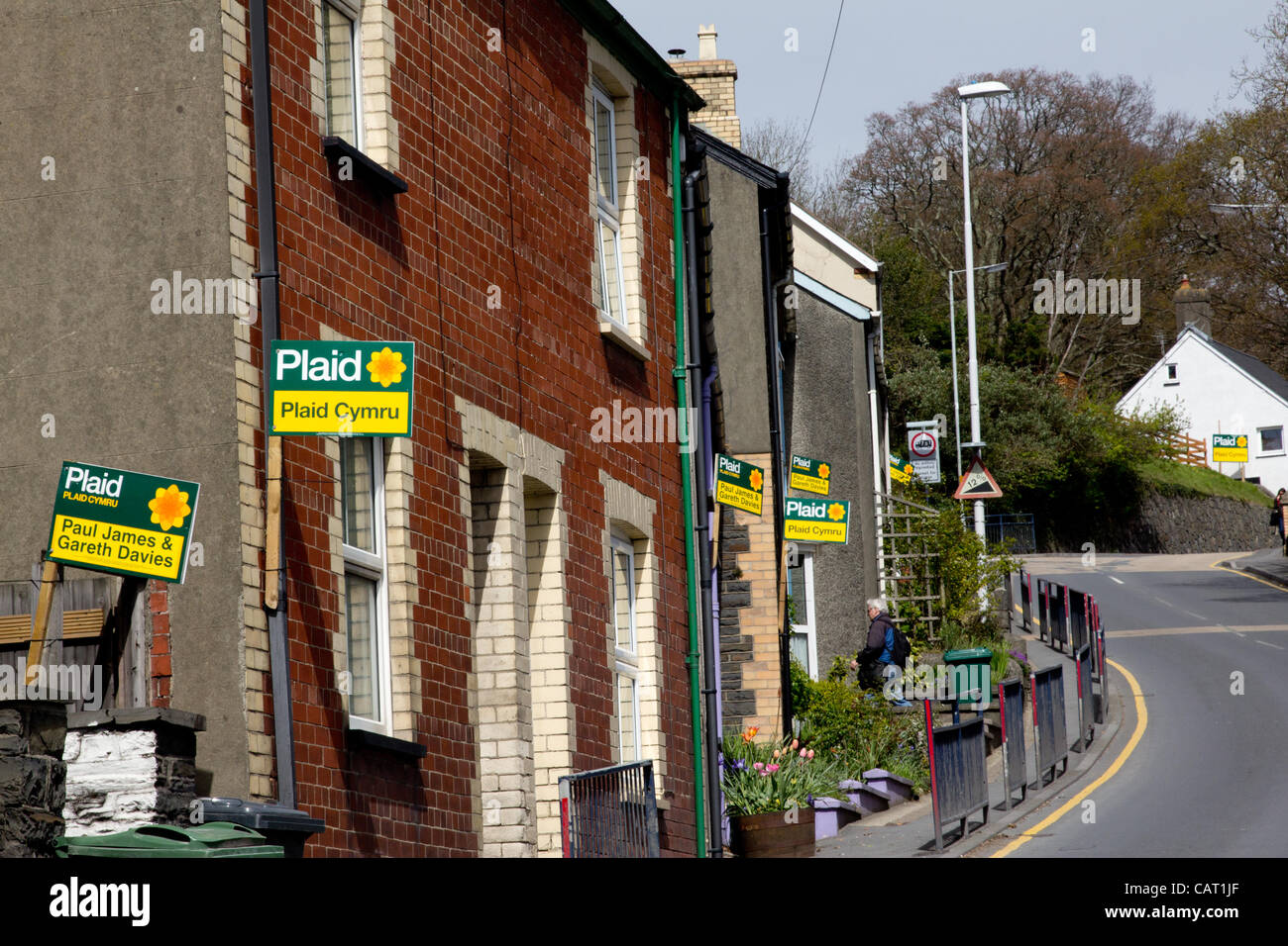 Wales, United Kingdom, April 17, 2012. Plaid Cymru (Welsh Nationalist party)  placards dominate the village of Llanbadarn - Stock Image