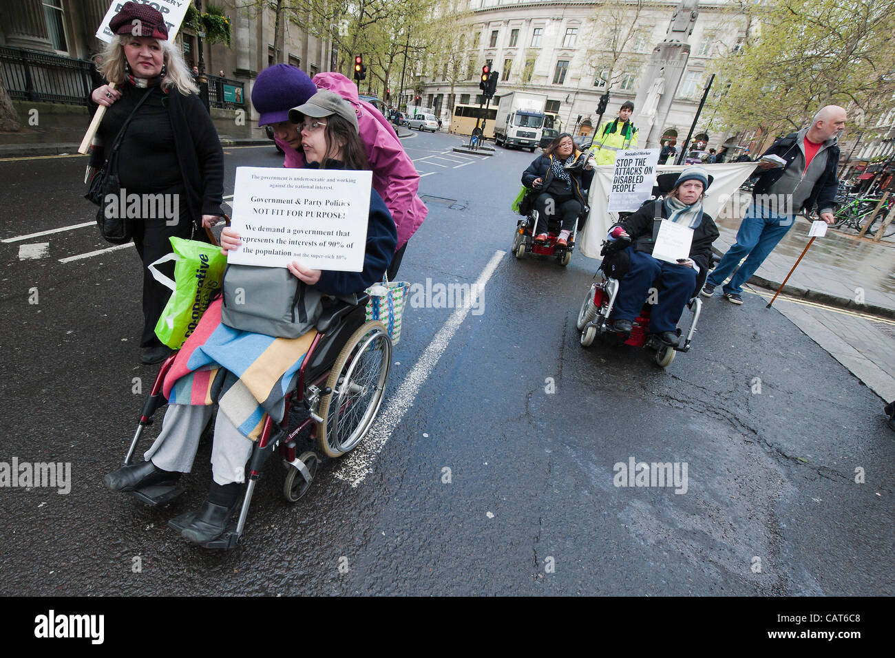 Members of DPAC (Disabled people against cuts) and UKUncut march from Leicester Square to Trafalgar Square where Stock Photo