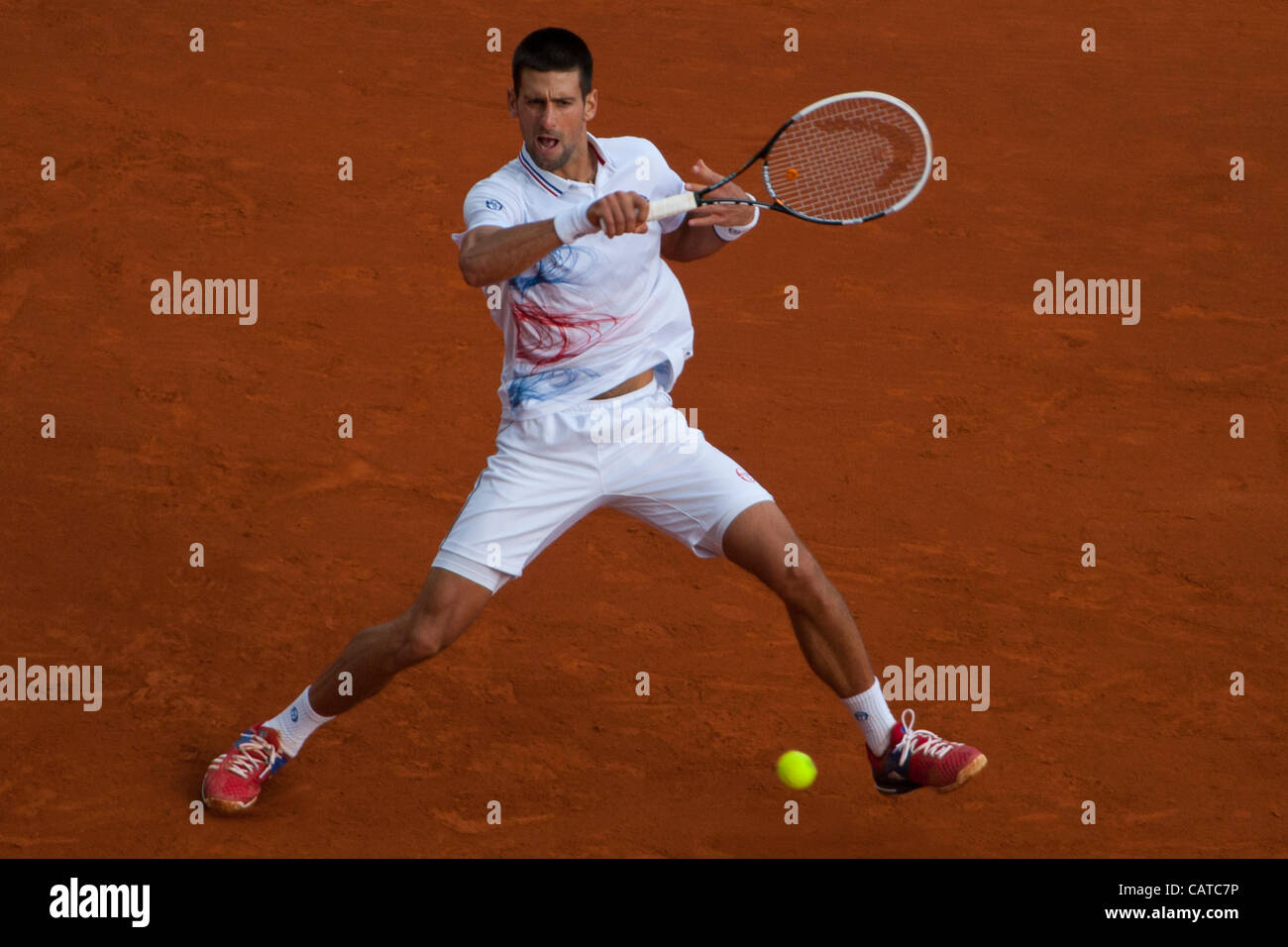 19/04/2012 Monte Carlo, Monaco. in action during the 3rd round singles match between Novak Djokovic (SRB) and Alexandr - Stock Image