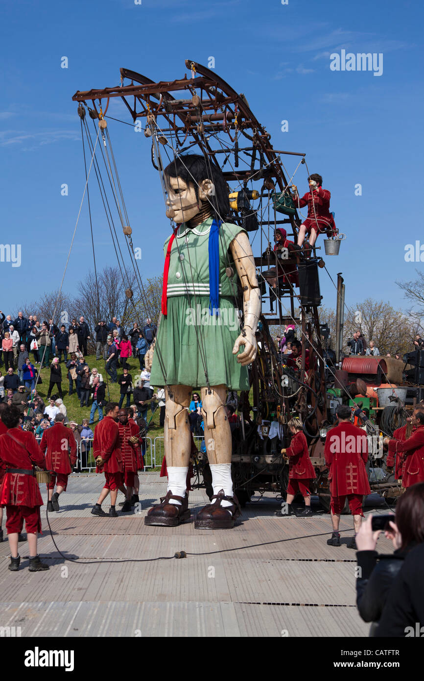 Liverpool, UK, Friday 20th April, 2012. The giant little girl puppet starts her walk around the city on the first - Stock Image