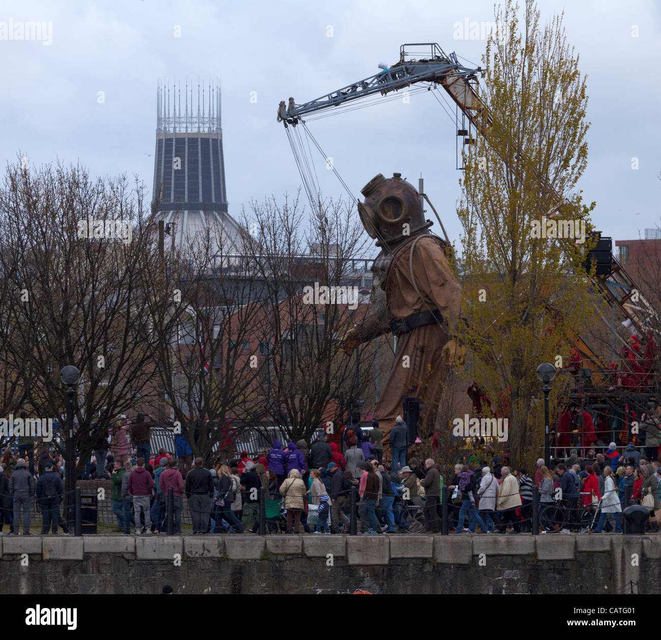 Liverpool, UK, Friday 20th April, 2012. The giant uncle puppet starts his walk around the city on the first of a - Stock Image
